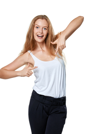 woman pointing: Happy excited woman pointing at herself over white Stock Photo