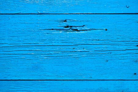 fringes: Old wooden planks painted with blue paint with brush fringes Stock Photo