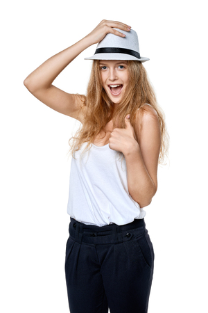 laugher: Happy excited woman with straw hat laughing at camera gesturing thumb up