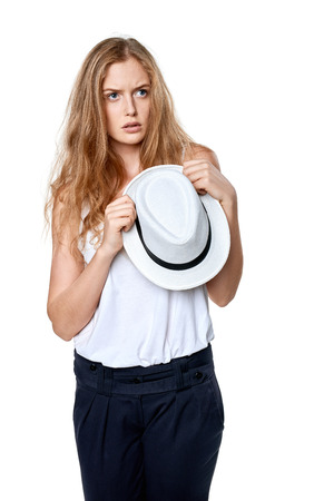 sullen: Displeased sullen woman holding straw hat looking away at blank copy space
