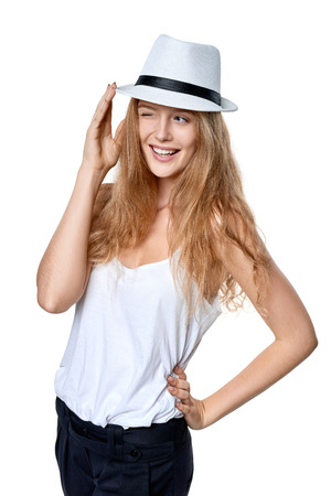flirt: Happy playful woman wearing straw hat winking and smiling looking to the side at blank copy space
