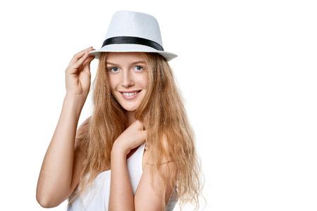 fedora: Closeup of smiling woman wearing white fedora straw hat over white background