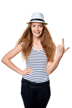 three fingers: Hand counting - two fingers. Happy summer woman in straw fedora hat showing three fingers