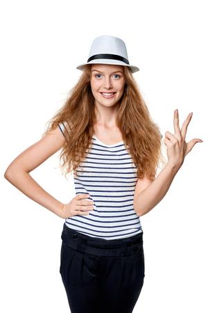 fedora: Hand counting - three fingers. Happy summer woman in straw fedora hat showing three fingers Stock Photo