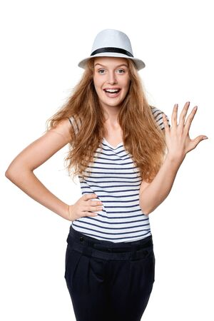 five fingers: Hand counting - five fingers. Happy summer woman in straw fedora hat showing five fingers
