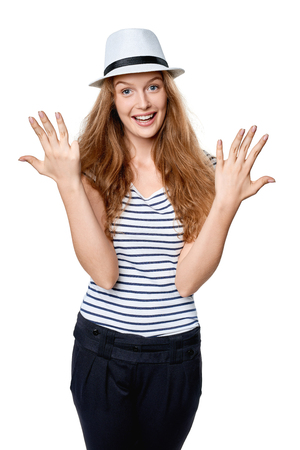 number ten: Hand counting - eight fingers. Happy excited summer woman in straw fedora hat indicating the number ten with her fingers Stock Photo