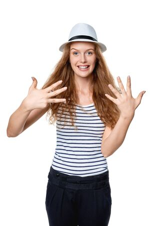 fedora: Hand counting - eight fingers. Happy excited summer woman in straw fedora hat showing eight fingers