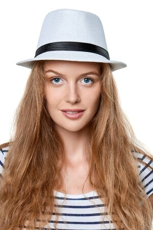 girl in a hat: Closeup portrait of young smiling woman in white straw hat looking at camera, over white background