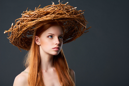 wood nymph: Closeup of beautiful woman in natural wreath of wicker, studio portait with copy space