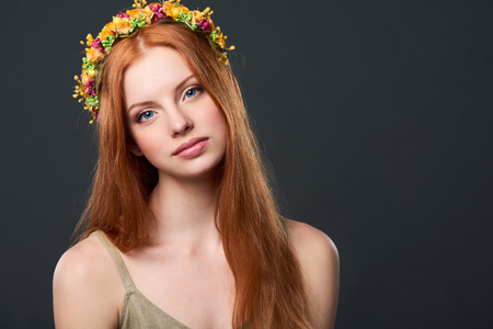 Closeup of beautiful red haired woman in flower wreath
