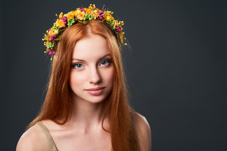 red haired: Closeup of beautiful red haired woman in flower wreath