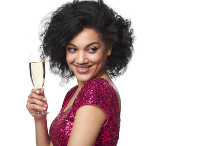 sequined: Party, drinks, holidays and celebration concept. Closeup happy smiling laughing mixed race woman in sequined dress with glass of champagne looking to the side at blank copy space