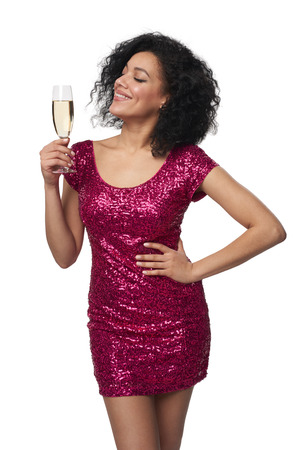 Party, drinks, holidays and celebration concept. Happy woman in sequined dress with glass of champagne enjoying with closed eyes Stock Photo