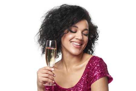 sequined: Party, drinks, holidays and celebration concept. Closeup happy smiling woman in sequined dress with glass of champagne enjoying with closed eyes Stock Photo
