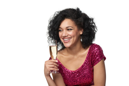 laugher: Party, drinks, holidays and celebration concept. Closeup happy playful laughing woman in sequined dress with glass of champagne looking to side at blank copy space