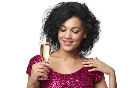 sequined: Party, drinks, holidays and celebration concept. Closeup smiling glamourous woman in sequined dress with glass of champagne looking down Stock Photo