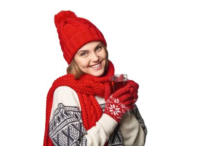 warm clothing: Closeup of young smiling woman in warm winter clothing with cup of tea on white background Stock Photo