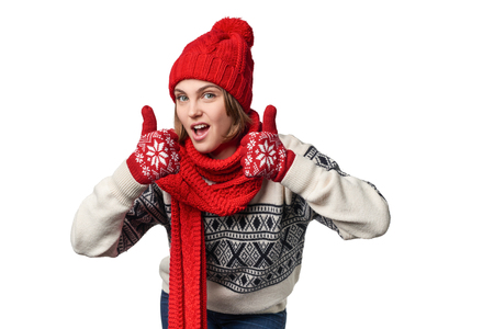warm clothing: Excited winter warm clothing girl giving double thumb up, over white background Stock Photo