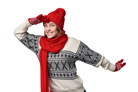 laugher: Happy excited winter woman holding palm on forehead observing, over white background Stock Photo