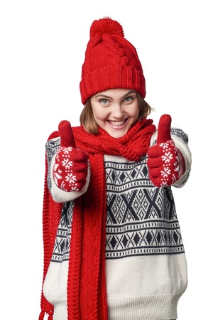 warm clothing: Excited winter warm clothing girl giving double thumb up Stock Photo