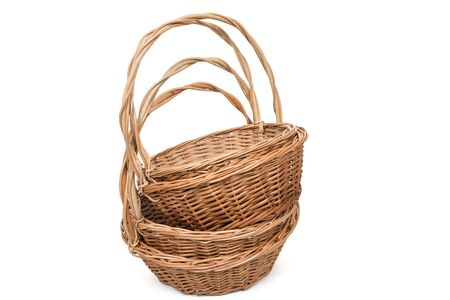 splint: Closeup of wicker baskets in a heap, isolated on white background