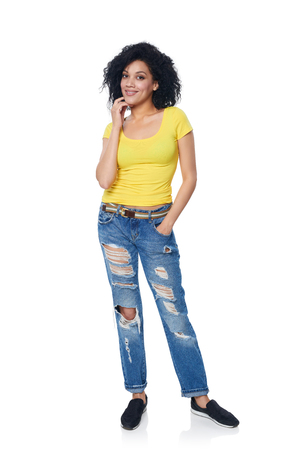 Full length funky female in distressed jeans over white background