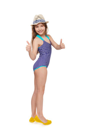 sunhat: Full length child girl in swimsuit and summer hat giving double thumb up, over white background