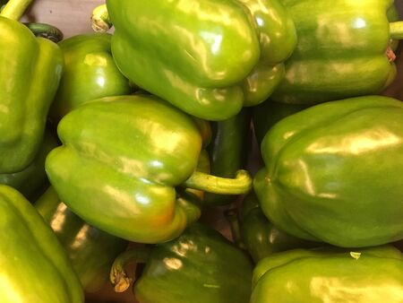 Top view of green peppers in a pile Stock Photo
