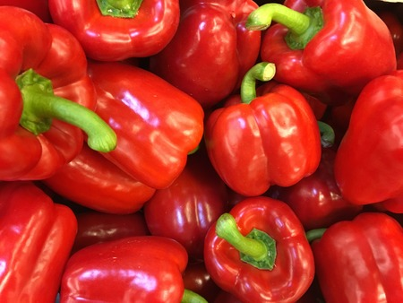 Top view of red peppers in a pile