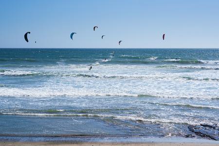 Remote view at kite surfers riding the waves in Santa Cruz, California