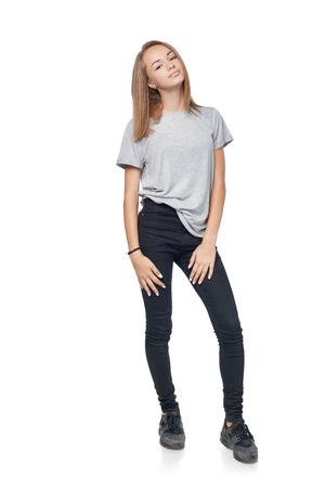Teen girl in full length standing posing, isolated on white background Reklamní fotografie