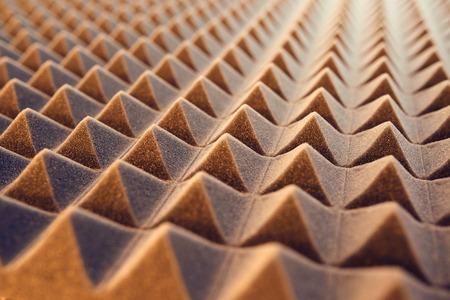 Closeup pattern of acoustic foam panel background, toned image