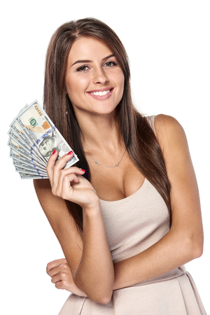 Smiling woman with us dollar money in hand over white background Stock Photo