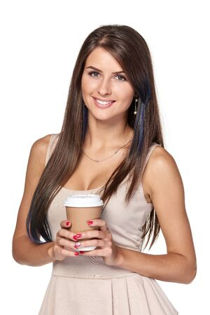 Beautiful woman holding hot drink in disposable paper cup, isolated over white background