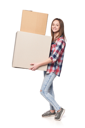 Delivery, relocation and unpacking. Smiling young woman holding cardboard boxes isolated on white background
