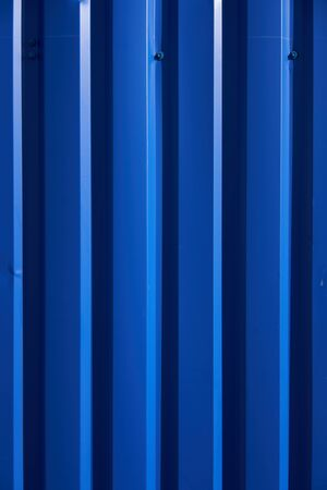 Container pattern. Corrugated metal profiled panel. Metal rivets. Background of blue metal siding, corrugated iron sheet for exterior decoration Stock Photo