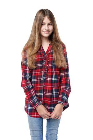 Teen girl in checkered shirt standing casually over white background Reklamní fotografie