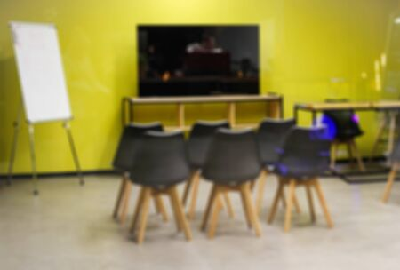 blurred background. Presentation room in yellow