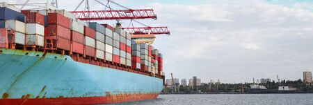 Container cargo ship load in the seaport. Logistics and transportation of Container Cargo ship with working crane bridge in shipyard, logistic import export. Space for text 스톡 콘텐츠
