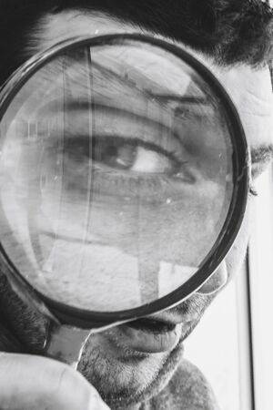 the big eye through a magnifying glass examines us