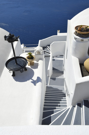 stair well: Stairs view in Santorini island Stock Photo