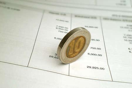 investmen: Coin on Bank Statement
