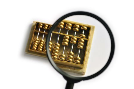 A golden abacus with part of it magnified photo