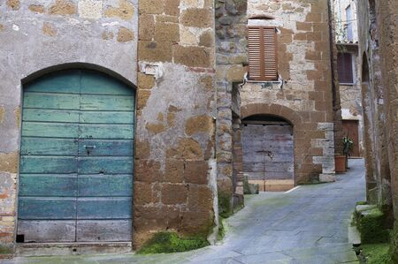 foreshortening: Alley with colorful wooden doors in Pitigliano