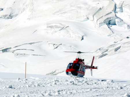 A helicopter landed at the foot of the Jungfrau mountain (Jungfraujoch). 3466 meters of altitude