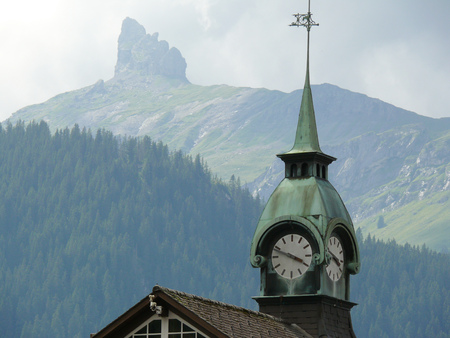 A mountain top and in the foreground the bell tower with the clock.  08042009.