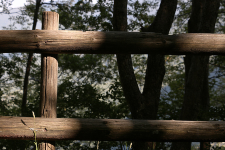 Parapet consisting of wooden poles in the Tuscan mountains. Stock Photo