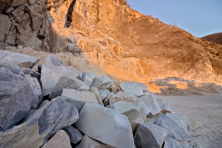 The precious white Carrara marble has been extracted from the Alpia Apuane quarries since Roman times. Today workers are helped by mechanical equipment (excavators, diamond wire machines and transport trucks).