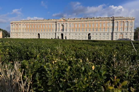 The external facade of the palace of Caserta. In the foreground the boxwood plants of the apio garden. Editorial