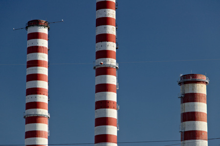 The white and red chimneys belong to the Iren plant in Turbigo, near Milan, Lombardy Standard-Bild - 122618576